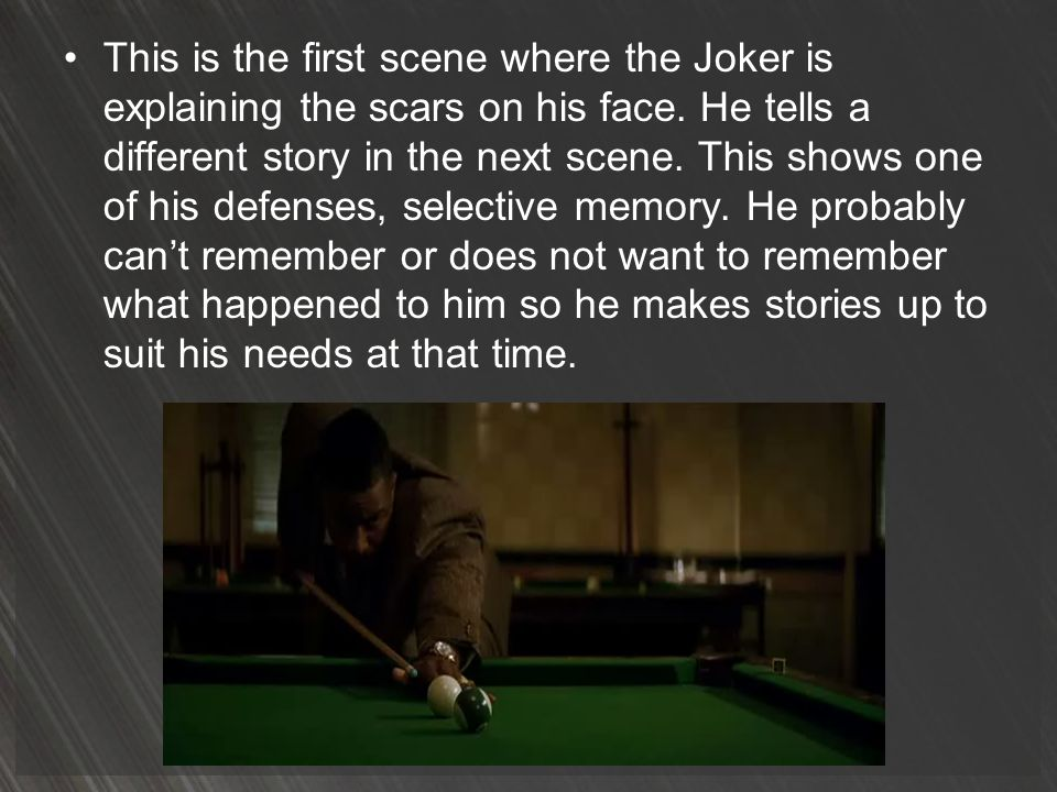 This is the first scene where the Joker is explaining the scars on his face.