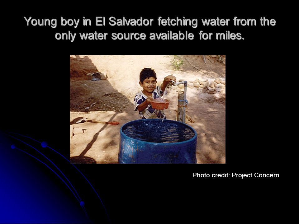 Young boy in El Salvador fetching water from the only water source available for miles.