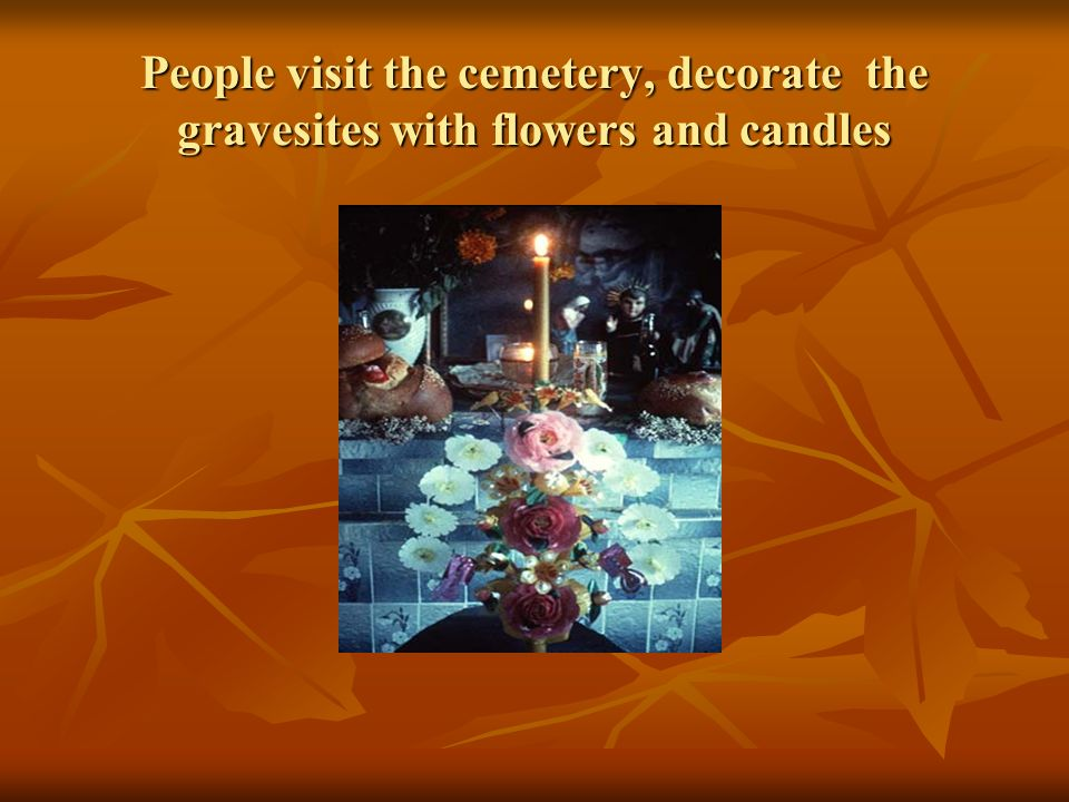 People visit the cemetery, decorate the gravesites with flowers and candles