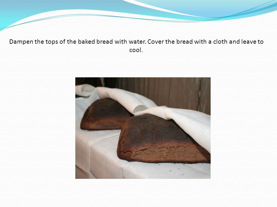 Dampen the tops of the baked bread with water