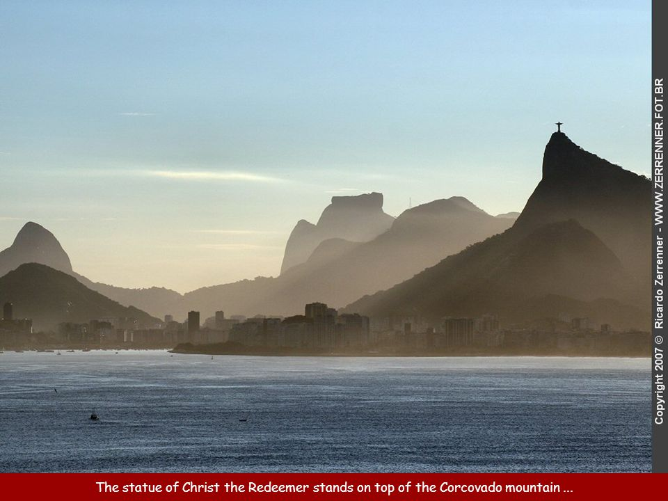 The statue of Christ the Redeemer stands on top of the Corcovado mountain ...