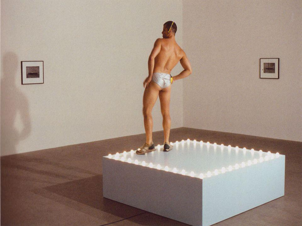 This is one of his work called Go-Go Dancer, who is listening to Walkman and dancing on that little stage.
