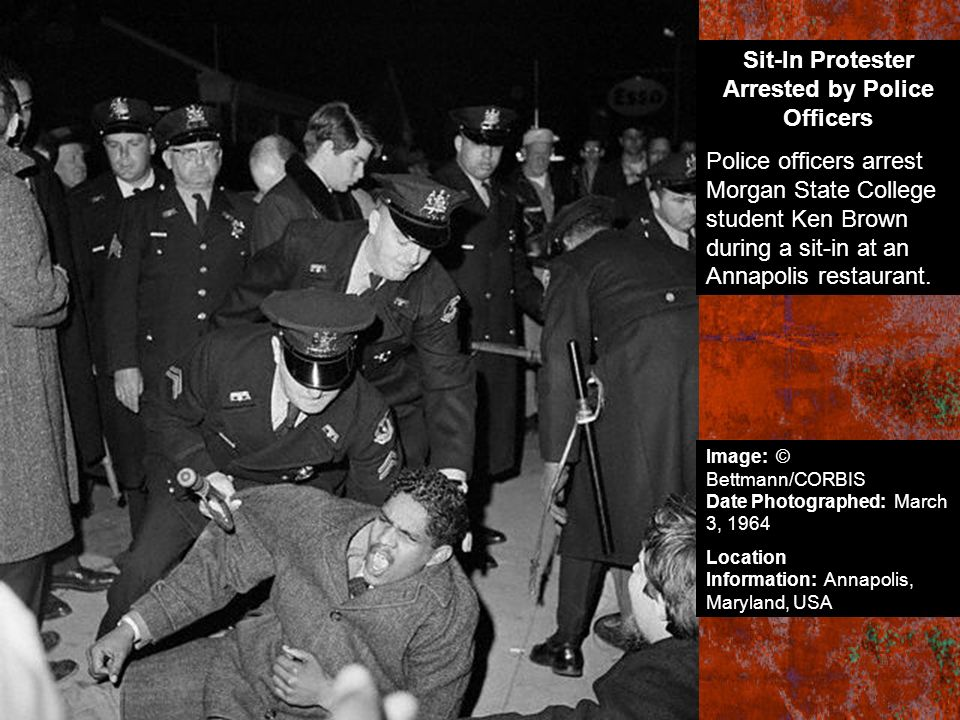 Sit-In Protester Arrested by Police Officers