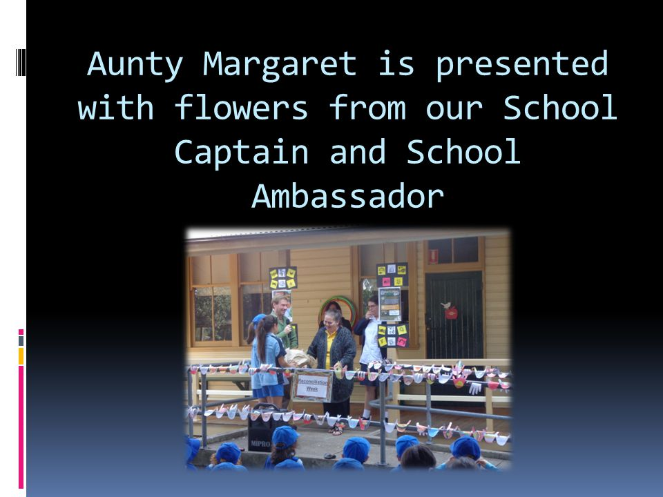 Aunty Margaret is presented with flowers from our School Captain and School Ambassador