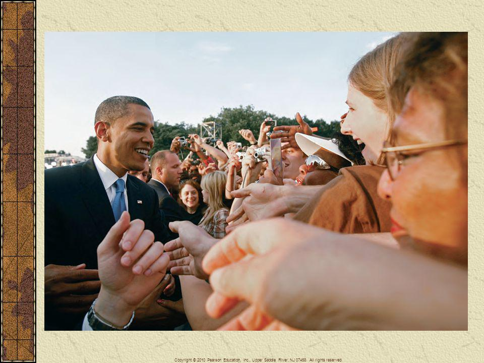 Barack Obama shakes hands with supporters in Berlin, Germany, on July 24, 2008, following a speech he gave before a crowd of tens of thousands at the Victory Column in Tiergarten Park.