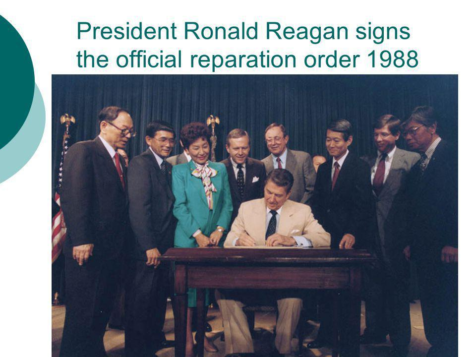 President Ronald Reagan signs the official reparation order 1988