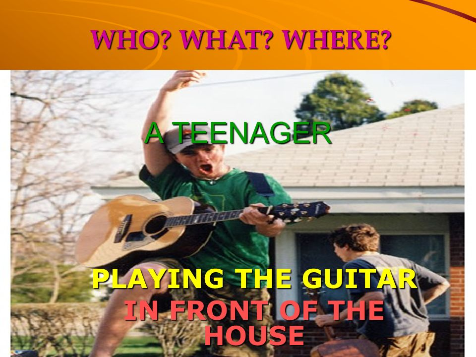 PLAYING THE GUITAR IN FRONT OF THE HOUSE