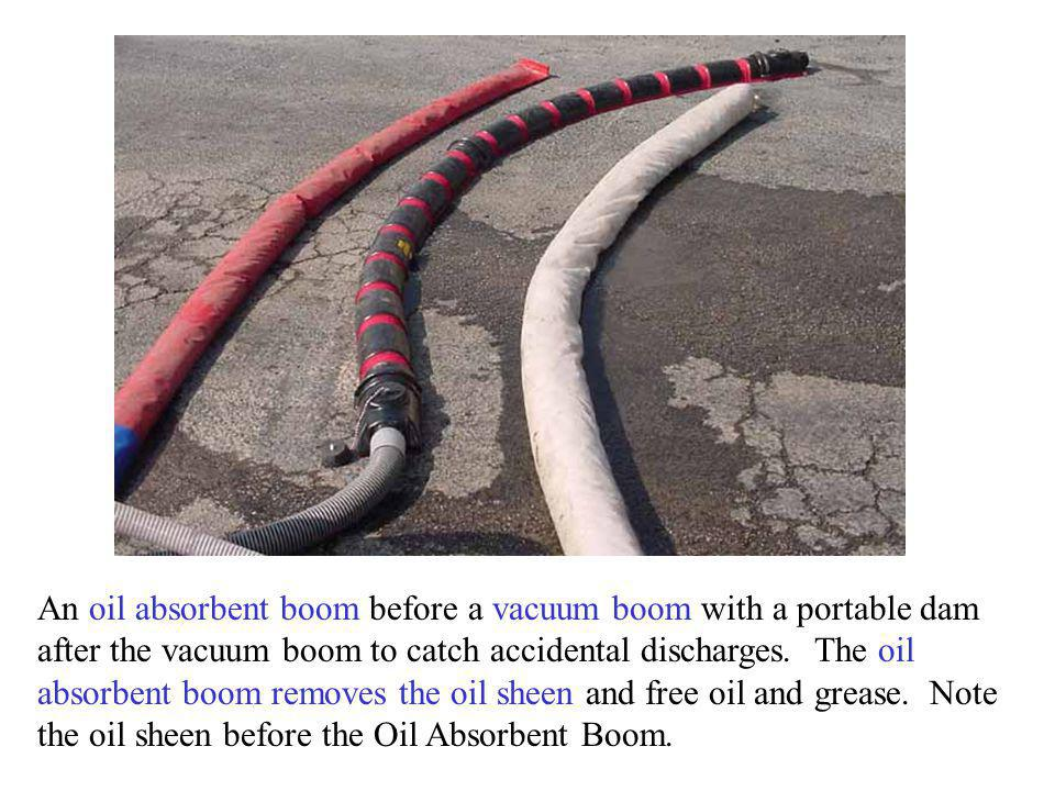 An oil absorbent boom before a vacuum boom with a portable dam after the vacuum boom to catch accidental discharges.
