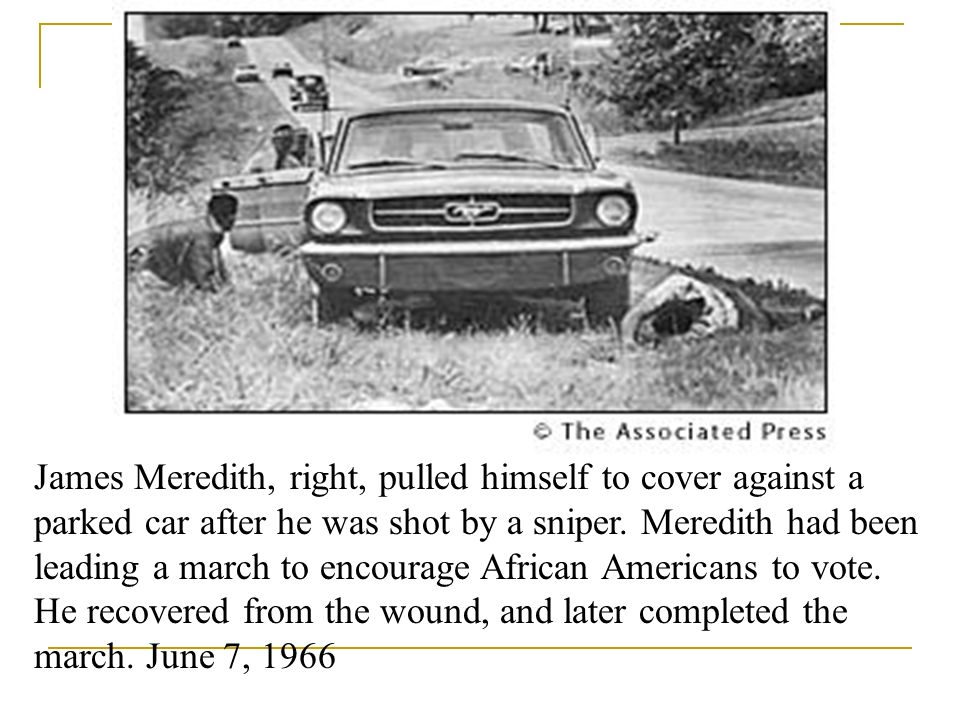 James Meredith, right, pulled himself to cover against a parked car after he was shot by a sniper.