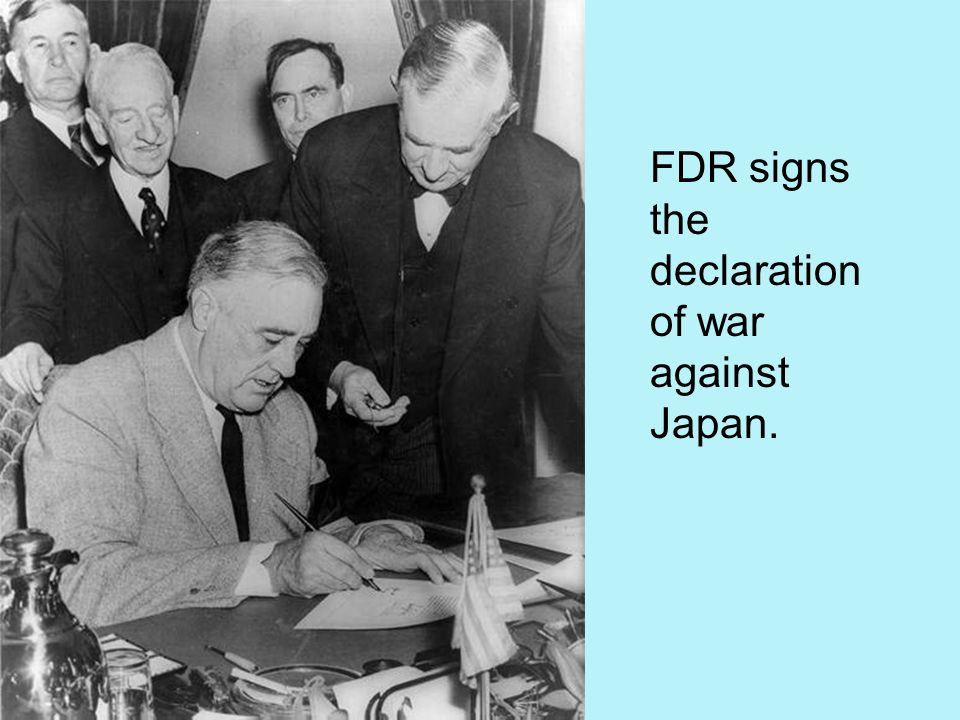 FDR signs the declaration of war against Japan.