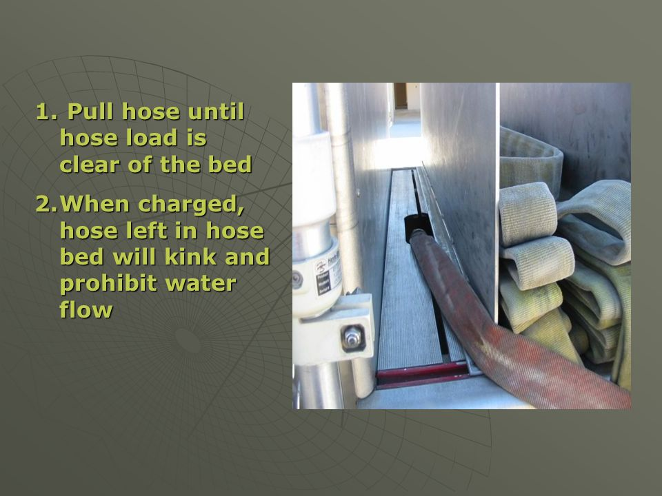 Pull hose until hose load is clear of the bed