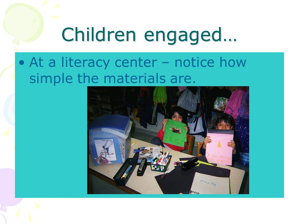 Children engaged… At a literacy center – notice how simple the materials are.