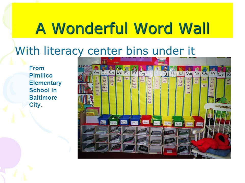 A Wonderful Word Wall With literacy center bins under it
