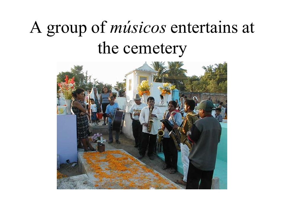 A group of músicos entertains at the cemetery