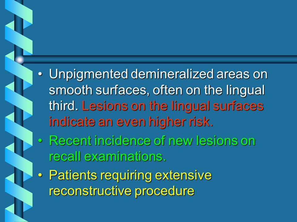 Unpigmented demineralized areas on smooth surfaces, often on the lingual third. Lesions on the lingual surfaces indicate an even higher risk.