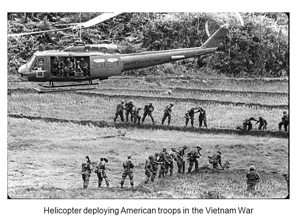 Helicopter deploying American troops in the Vietnam War