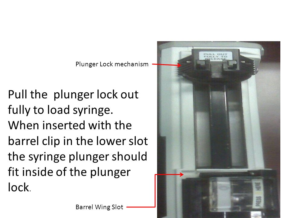 Pull the plunger lock out fully to load syringe.