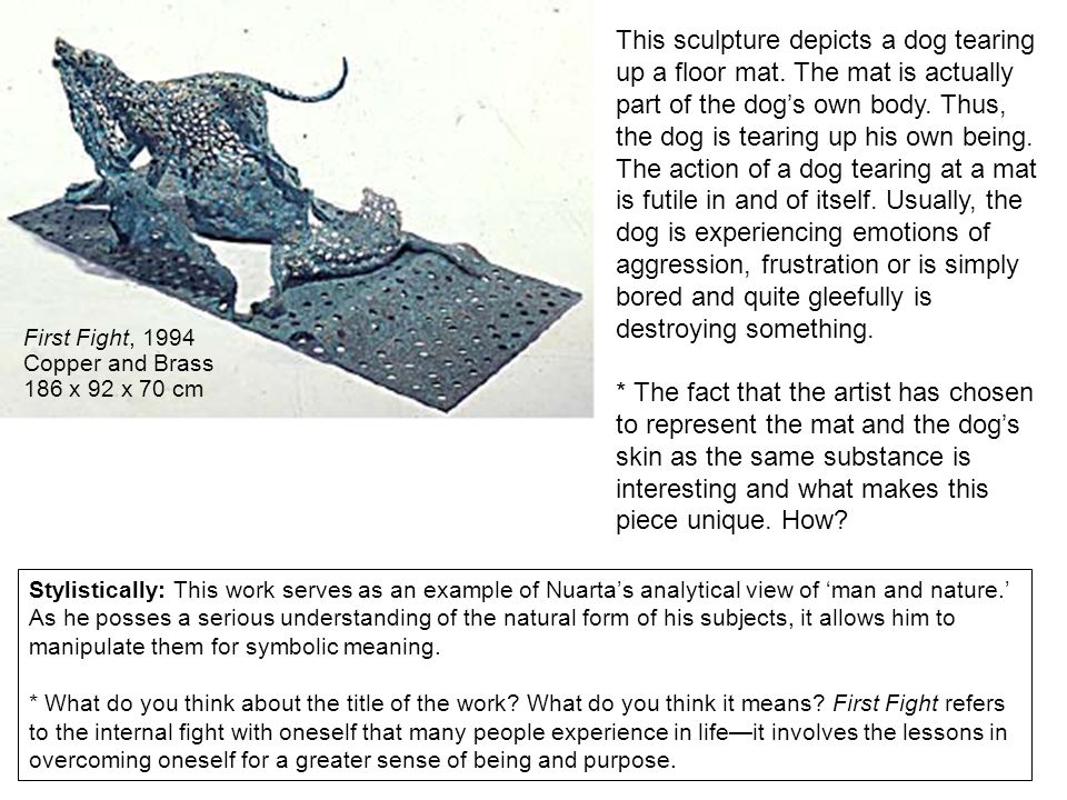 This sculpture depicts a dog tearing up a floor mat