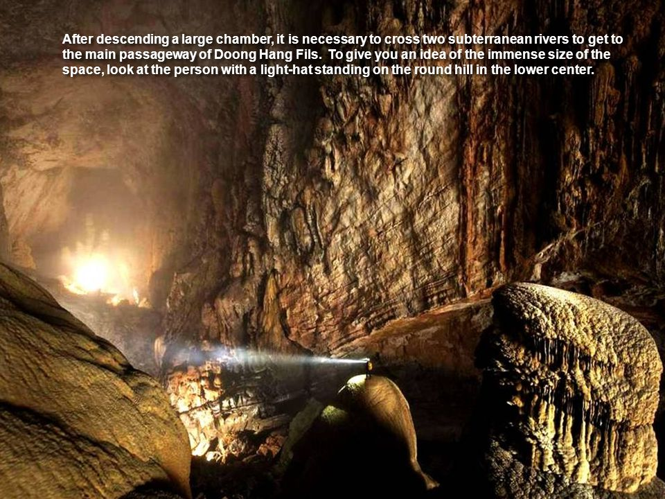 After descending a large chamber, it is necessary to cross two subterranean rivers to get to the main passageway of Doong Hang Fils.