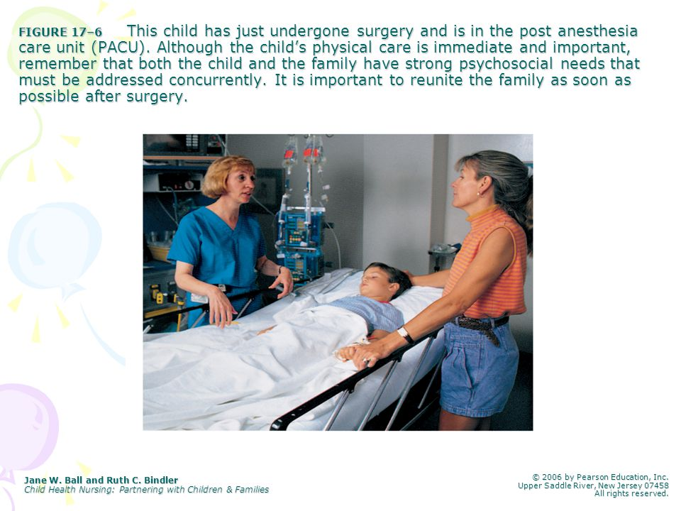 FIGURE 17–6 This child has just undergone surgery and is in the post anesthesia care unit (PACU). Although the child's physical care is immediate and important, remember that both the child and the family have strong psychosocial needs that must be addressed concurrently. It is important to reunite the family as soon as possible after surgery.