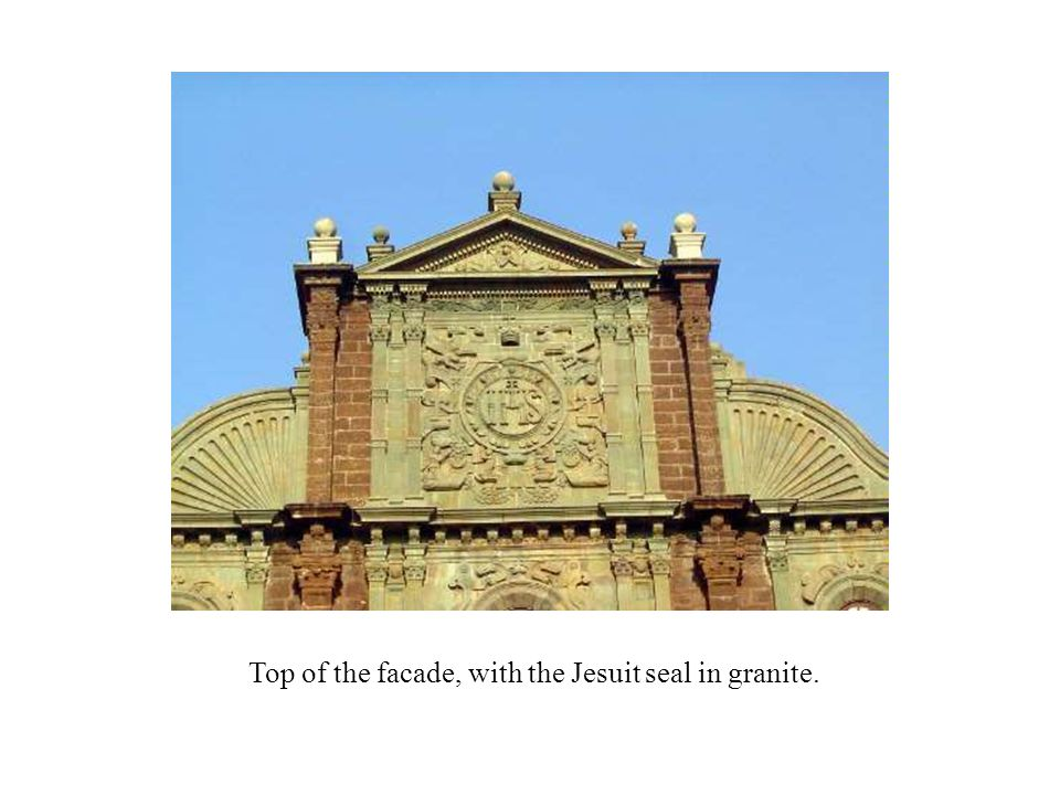 Top of the facade, with the Jesuit seal in granite.