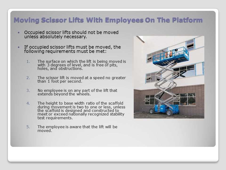 Moving Scissor Lifts With Employees On The Platform