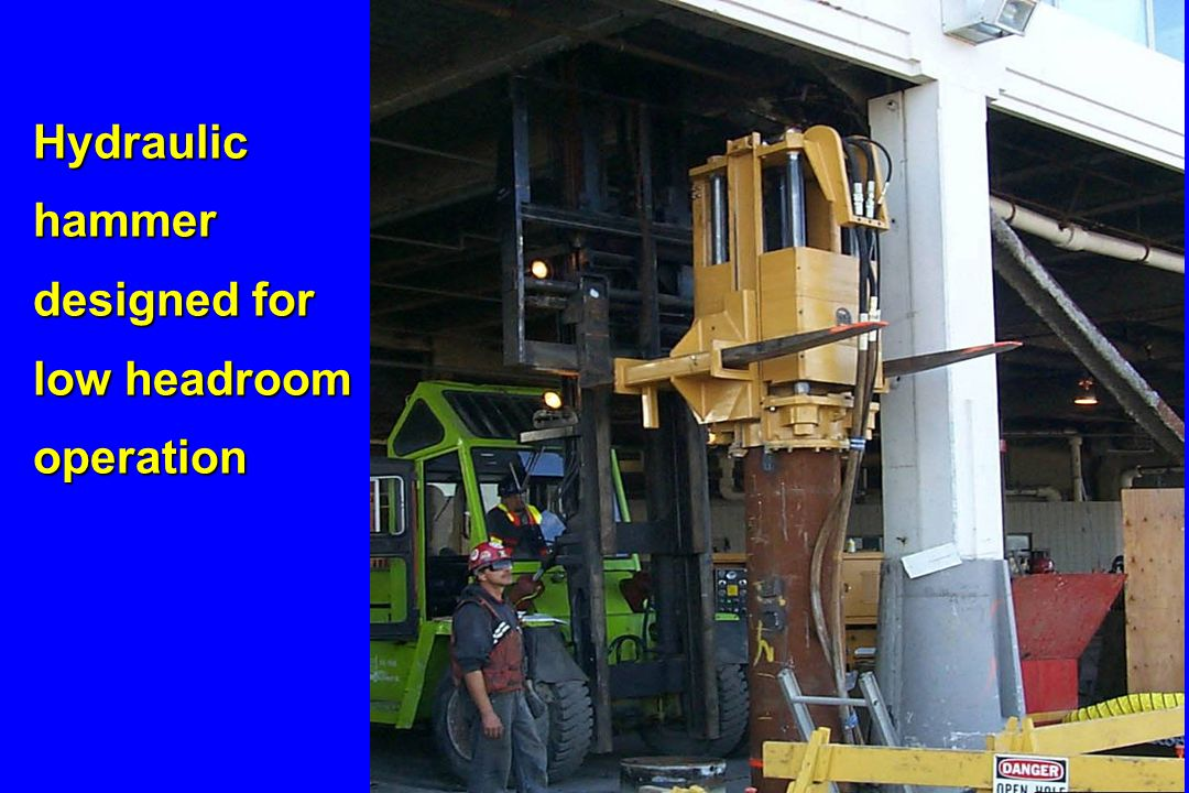 Hydraulic hammer designed for low headroom operation