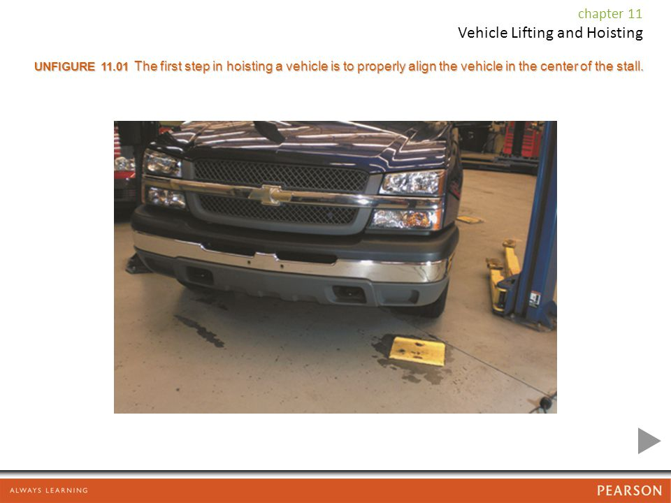 UNFIGURE The first step in hoisting a vehicle is to properly align the vehicle in the center of the stall.