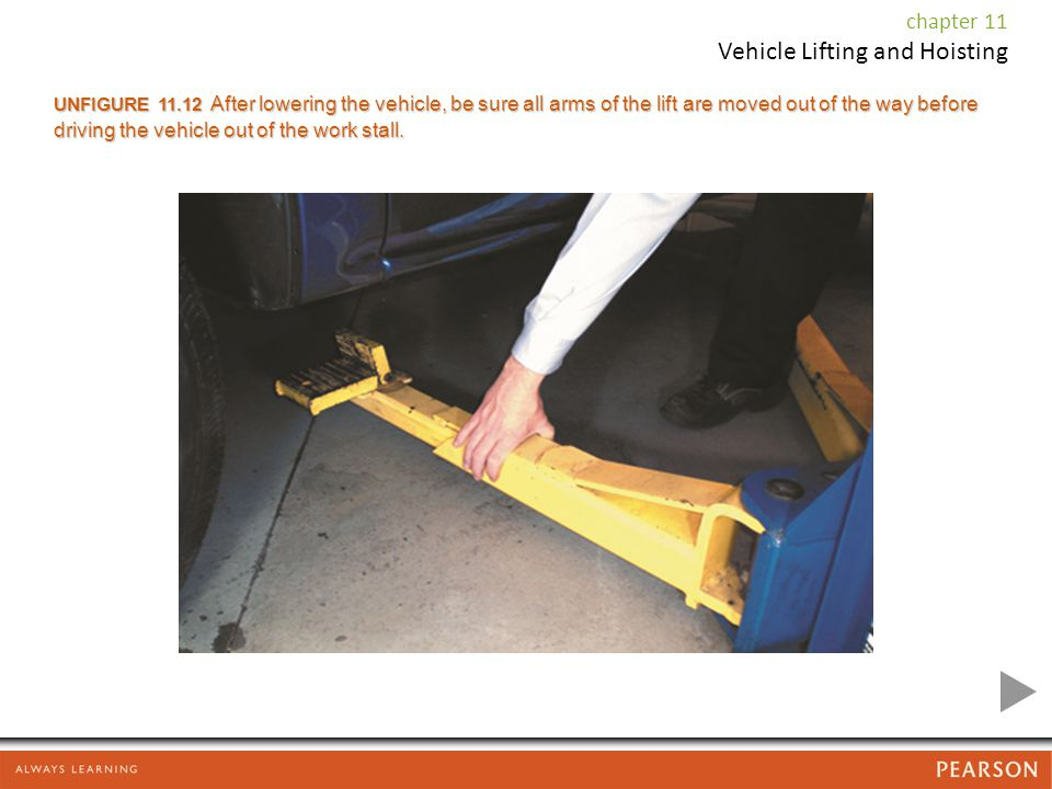 UNFIGURE After lowering the vehicle, be sure all arms of the lift are moved out of the way before driving the vehicle out of the work stall.