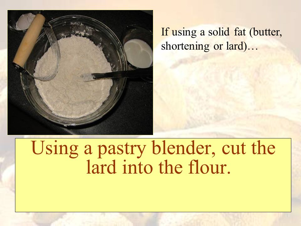 Using a pastry blender, cut the lard into the flour.