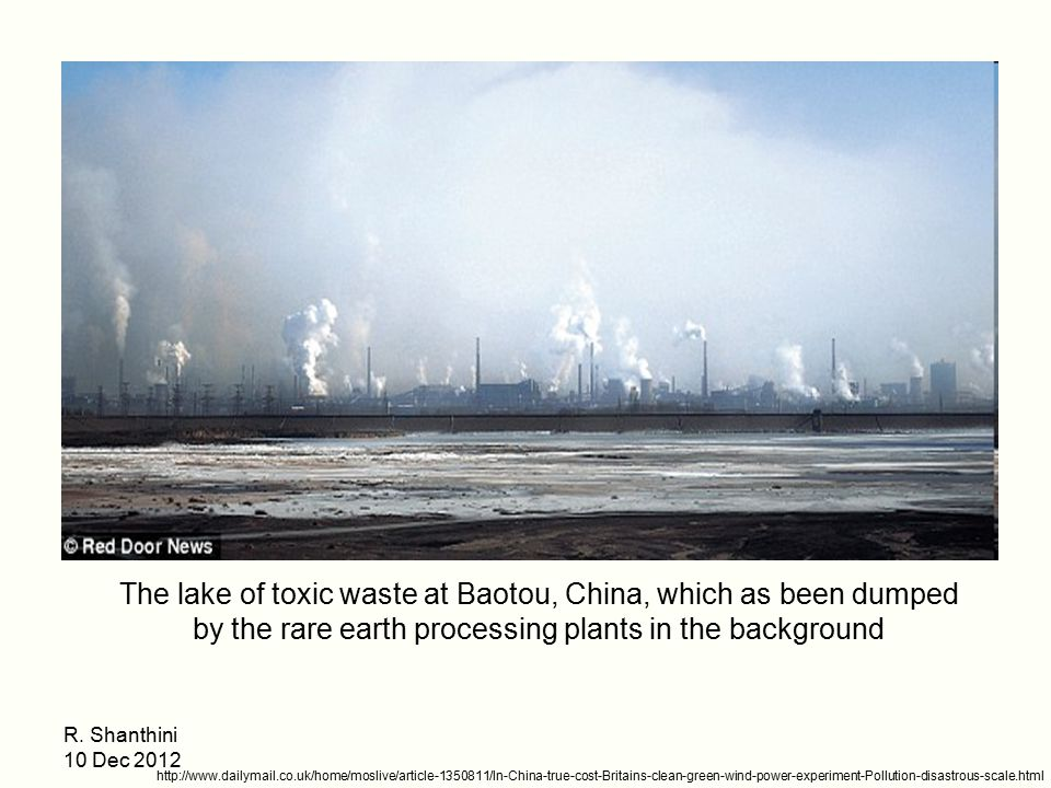 The lake of toxic waste at Baotou, China, which as been dumped by the rare earth processing plants in the background