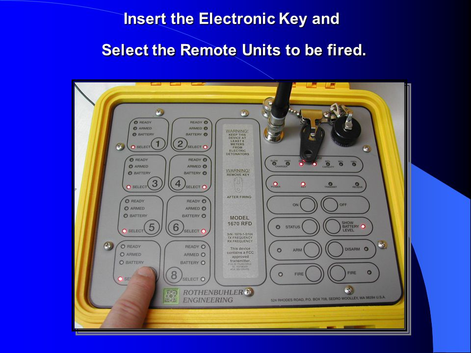 Insert the Electronic Key and Select the Remote Units to be fired.