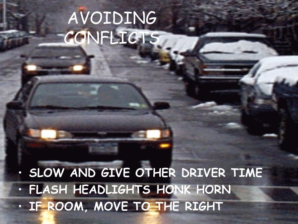 AVOIDING CONFLICTS SLOW AND GIVE OTHER DRIVER TIME