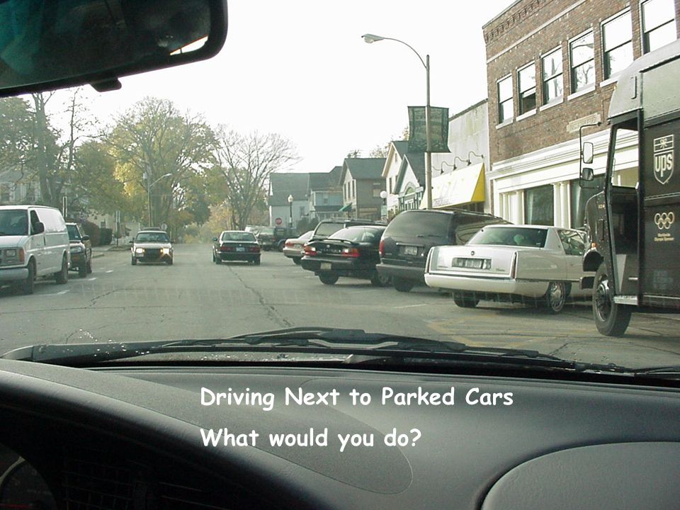 Driving Next to Parked Cars