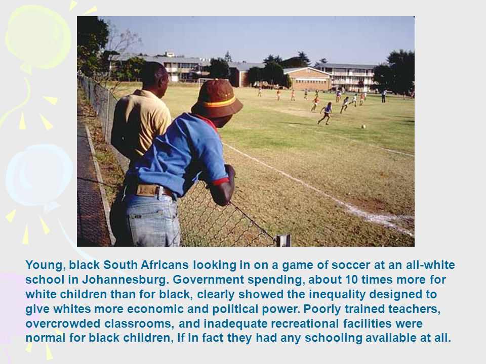 Young, black South Africans looking in on a game of soccer at an all-white school in Johannesburg.