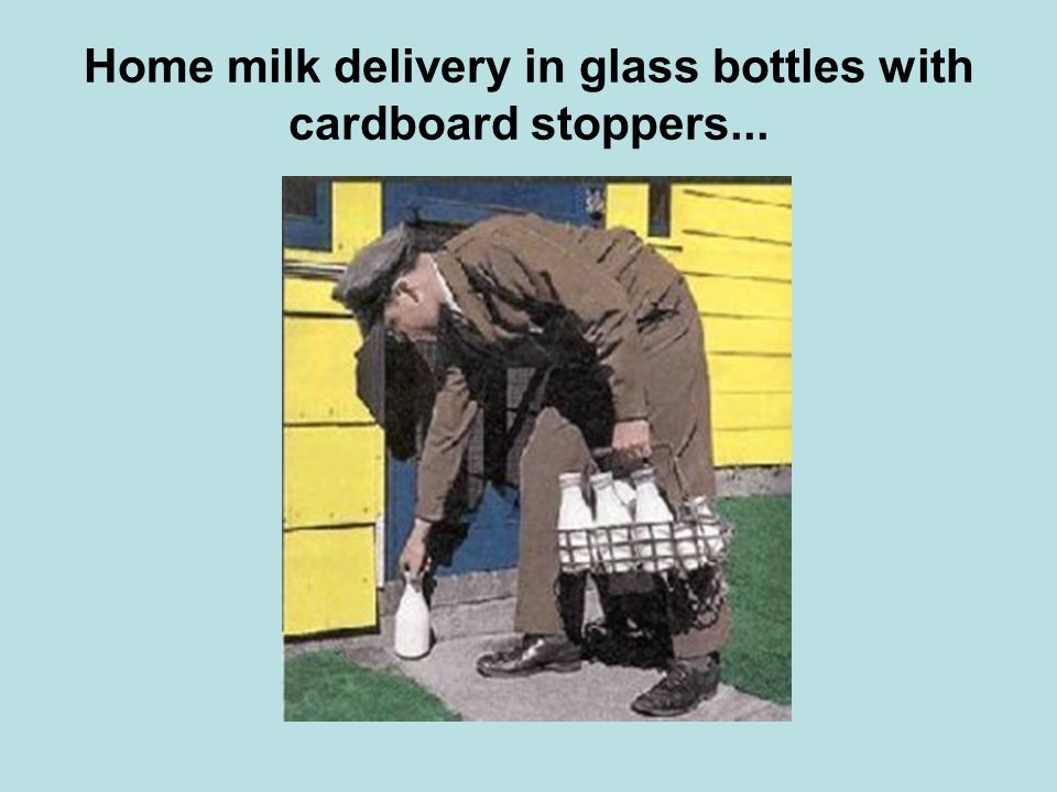 Home milk delivery in glass bottles with cardboard stoppers...