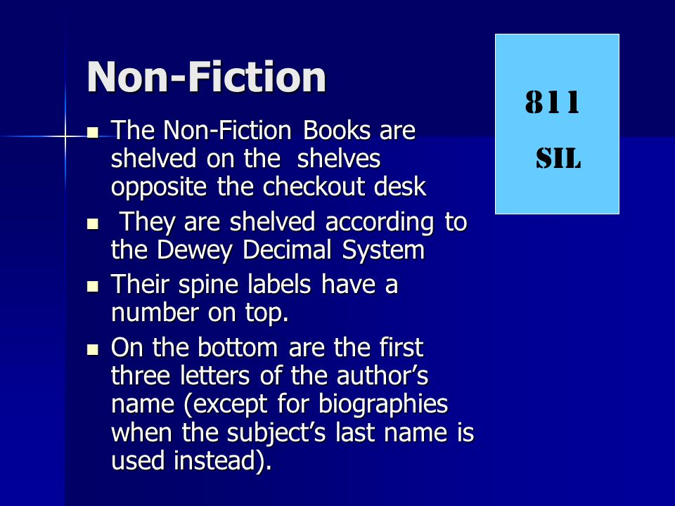 Non-Fiction 811. SIL. The Non-Fiction Books are shelved on the shelves opposite the checkout desk.
