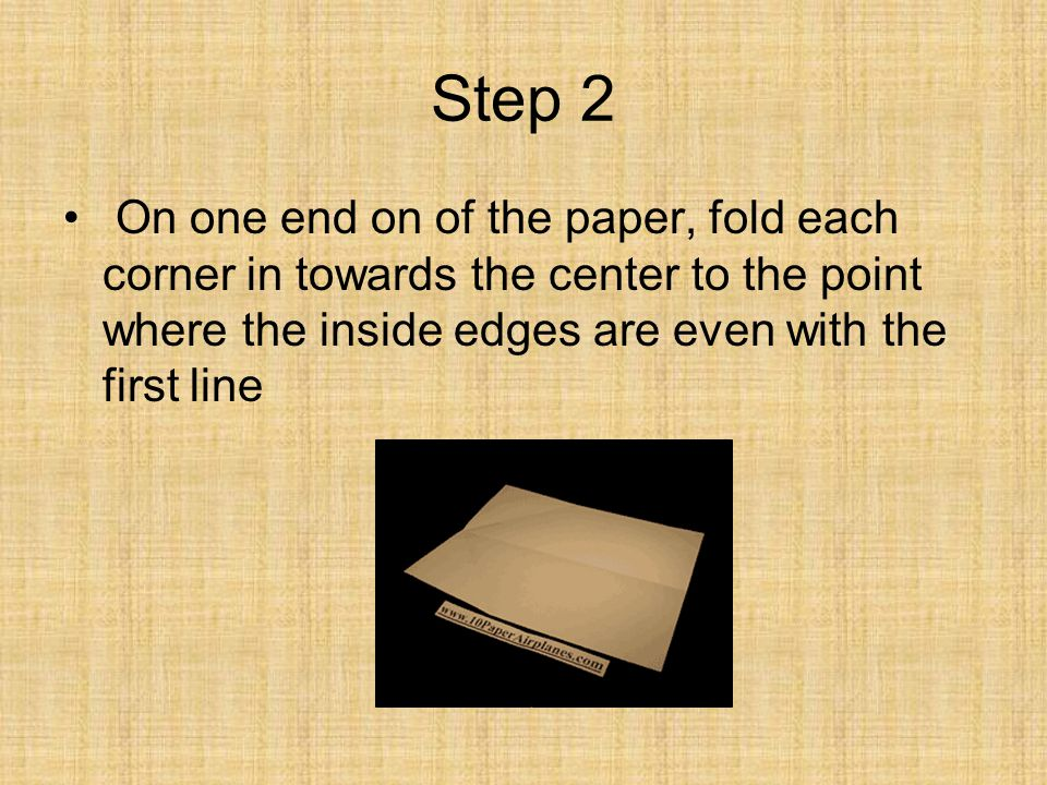 Step 2 On one end on of the paper, fold each corner in towards the center to the point where the inside edges are even with the first line.
