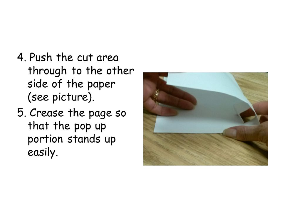 4. Push the cut area through to the other side of the paper (see picture).