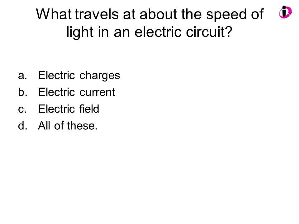 What travels at about the speed of light in an electric circuit