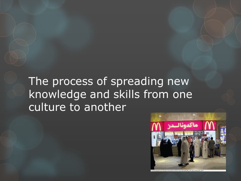 The process of spreading new knowledge and skills from one culture to another