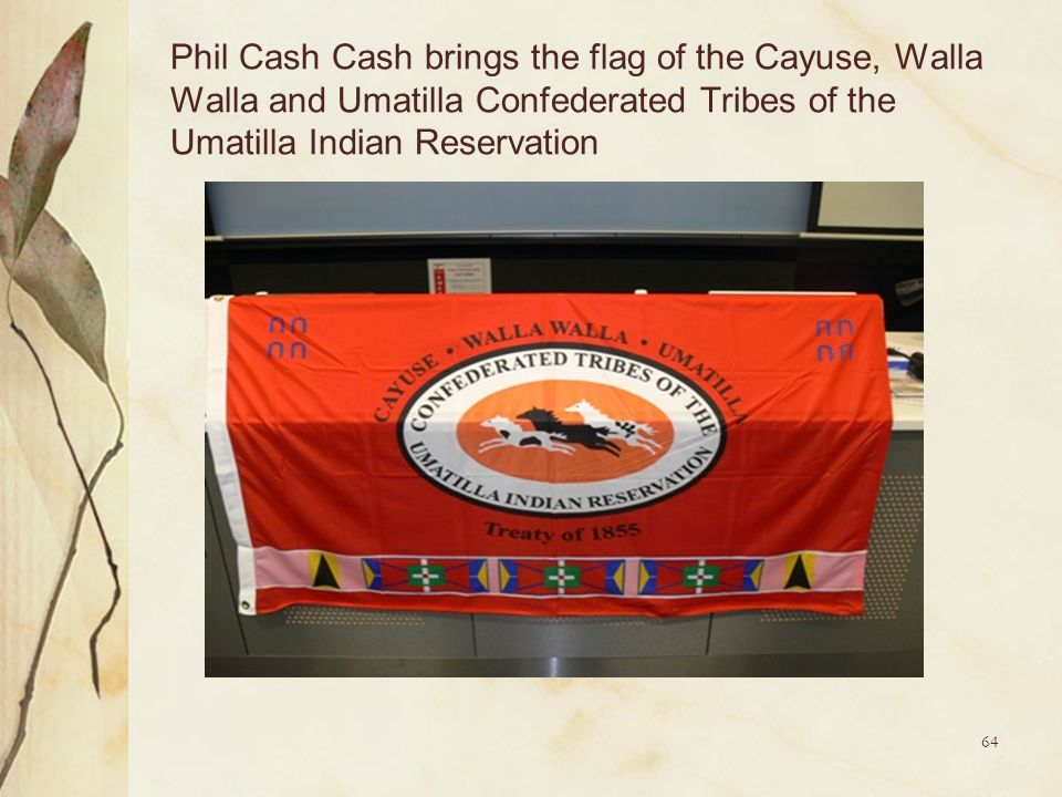 Phil Cash Cash brings the flag of the Cayuse, Walla Walla and Umatilla Confederated Tribes of the Umatilla Indian Reservation