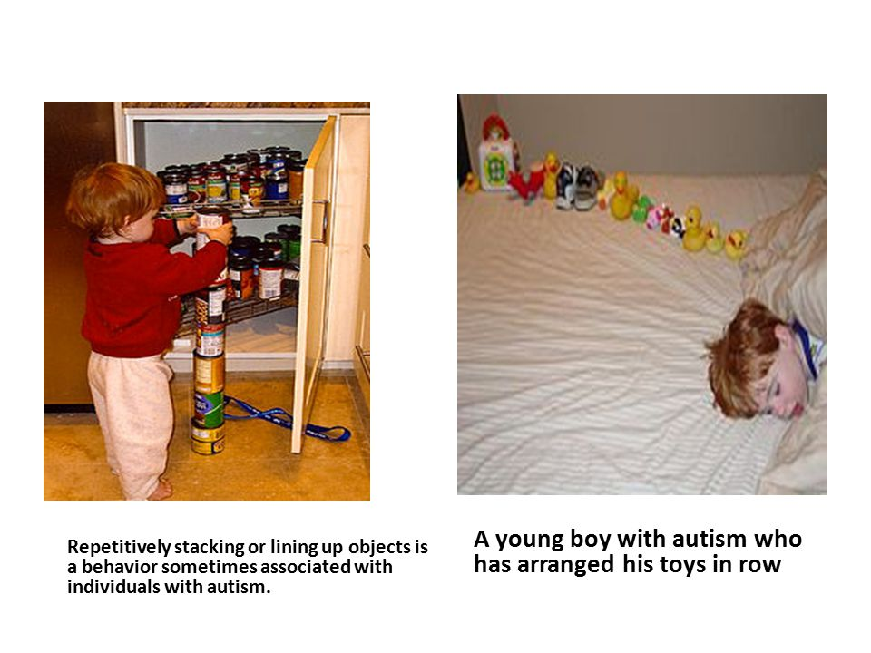 A Young Boy With Autism Who Has Arranged His Toys In Row
