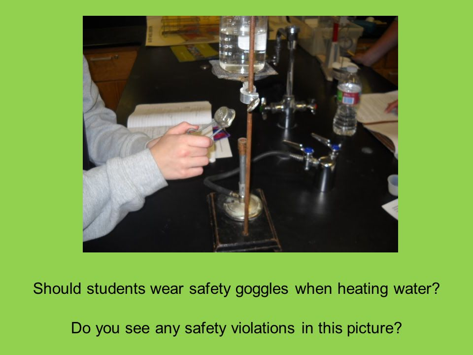 Should students wear safety goggles when heating water