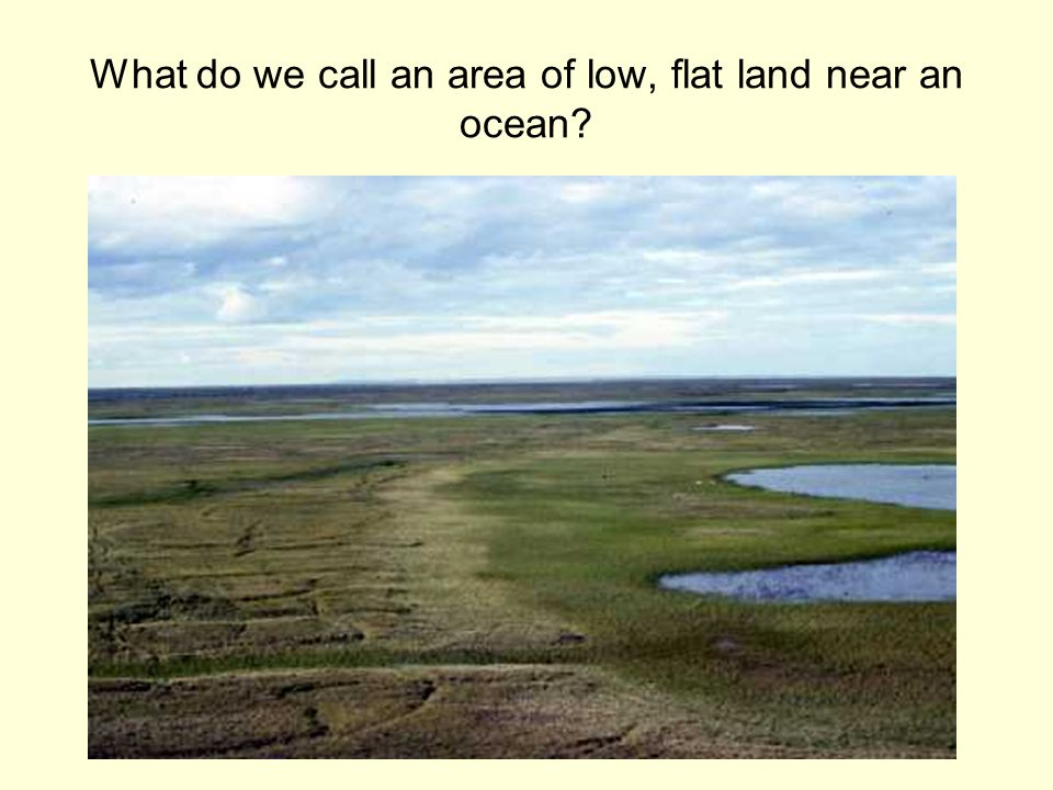 What do we call an area of low, flat land near an ocean